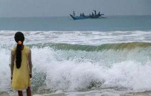 Girl watching Sri Lankan Fishermen by Miltos Gikas
